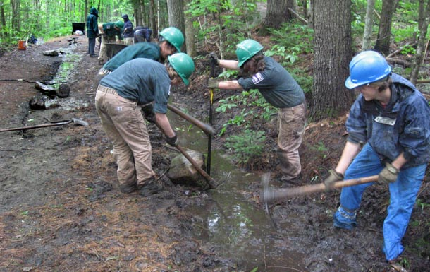VYCC crew digs ditch to fix washout