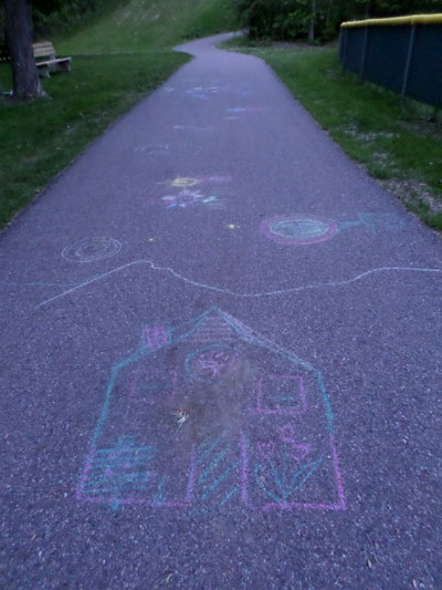 chalk drawing on paved path