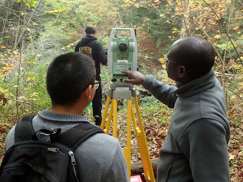 engineering students help on trail