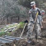 uniformed cadet shovels