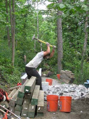 swinging hammer surrounded by trail building materials
